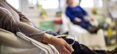 patient recieving chemotherapy through IV in a hospital ward