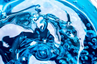 blue swirling liquid, the internal contents of a hydrogel bead