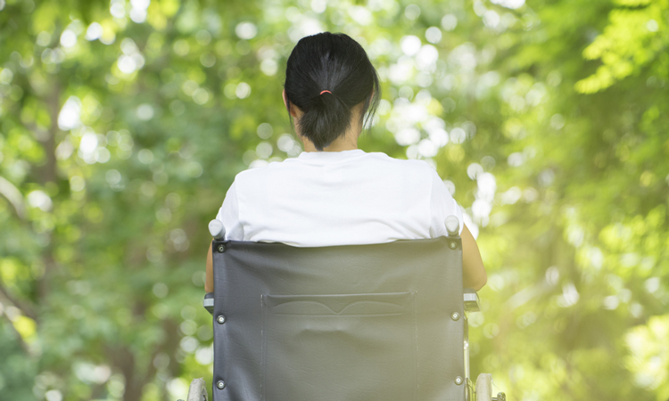Back of woman in a wheelchair